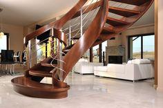 Ekskluzywne drewniane schody kręcone, z podwójną balustradą, rozszerzane na dole. Włodarczyk schody.