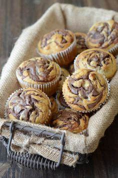 Nutella banana muffins..These look YUM.. I keep seeing great Nutella recipes but have been reluctant to try them because that means I will have a container of Nutella in my pantry begging me to eat it by the spoonful.. lol!
