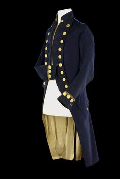 Rear admiral's undress coat worn by Nelson (1758-1805) at the Battle of the Nile in 1798. Blue wool, stand-up collar with non-working buttonholes and two small gilt brass flag officers buttons. The entire coat is lined with white linen, with the exception of the collar, which is lined with silk twill, and the right sleeve. The cuff of the right sleeve features a small black silk loop which was used to secure it to the front buttons of the lapels.