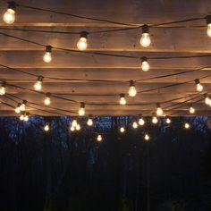 Drape patio lights from pergolas