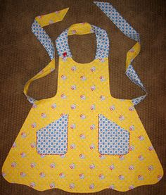 Don't you just love aprons? I do....so I decided it would be fun to make a few this year to add to my ever growing apron collection.  O...
