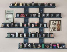 MADE BY: LUSNYAK DESIGNS Made my sister a shot glass display for her collection using pallet wood. Painted with navy color chalk paint and finished it with beeswax. Super happy with the result!