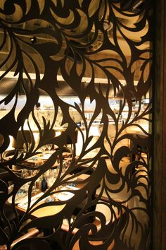 Laser cut screens - The Kitty Hawk restaurant, London - Feather design by Miles and Lincoln. www.milesandlincoln.com