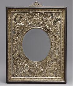 Relief mounted as a mirror frame Maker: Wenzel Jamnitzer (German, Vienna 1507/8–1585 Nuremberg) ca. 1568 German, Nuremberg Gilded silver, ebony, mirror plate