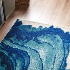 This is one of the neatest rugs I have ever seen. You really should see the whole thing. It looks like blue waves. So pretty.