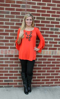 Orange, leggings and boots are a must for fall!