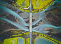 """<i>Patterns of Glacial River.</i> """"Aerial view of a glacial river in Iceland. While crossing the bridge, I noticed some patterns in the water and wondered how it would look from the sky. I stopped the car at a turnout after crossing the bridge and flew my drone to capture this image. I included the bridge and the car to give an idea of the scale. This river flows to the ocean and becomes part of the sea."""""""