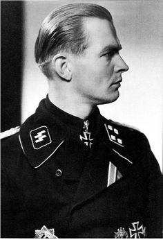 """Max Wünsche, who commanded Panzer Regiment 12 of the 12th SS-Panzer Division Hitlerjugend, was described by his captors as """"PW is definitely a museum piece. He is 150% Nordic warrior, wearing every order of the Iron Cross; an officer of the Leibstandarte since 1933 on and a fanatic of the most extreme order, with a well disciplined and calculating brain. His information is reliable on military matters, but his attitude is irreconcilable""""."""