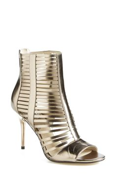 Head over heels for these silver Michael Kors caged sandals.