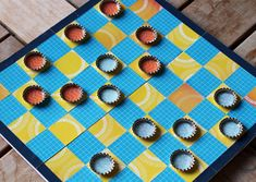 Travel checker board, could be done with duct tape instead of scrapbook paper