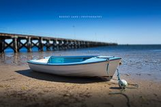 Boat stuck on low tide, jetty in background, Streaky Bay - South Australia by Robert Lang Photography, via Flickr