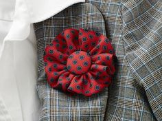 "DIY Necktie Fabric Boutonniere -- LOVE LOVE LOVE this idea for old ties -- now a woman's ""tie flower"" -- how professional looking."