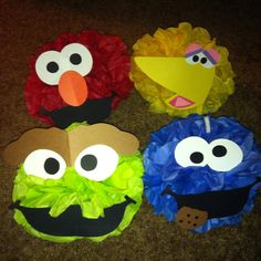 Sesame street pom poms I made with tissue and construction paper