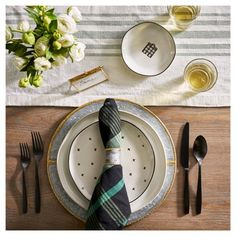 Go from everyday ease to special settings with modern, farmhouse serveware. Simply layer stoneware plates, stainless steel flatware and a woven plaid table runner onto your existing dining room style for functional flair. Less work. More family.