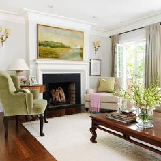 Design ideas for this room were inspired by the painting above the mantle.  I love that idea.