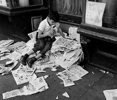 On Reading: Andre Kertesz boy reading newspaper