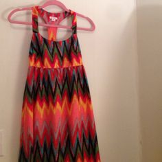 Vibrant Chevron Maxi Dress Vibrant, colorful fun Maxi. 100% polyester, racer back with stretchy fabrication makes this super comfortable and airy. I love this dress. So many compliments and so flattering!! Chevron pattern. You'll look and feel great in this! Worn once. Xhilaration Dresses Maxi