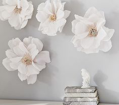 Crepe Paper Flower Décor:  White paper flowers for infant or toddler room walls brighten up a room. #nurserydecor #babyroom #nurseryinspiration