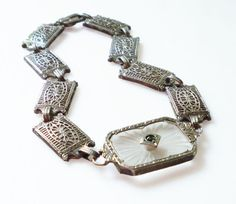 Hey, I found this really awesome Etsy listing at https://www.etsy.com/listing/241747091/art-deco-camphor-bracelet-sterling