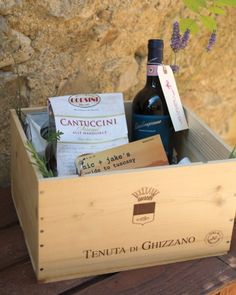 Guests at this Tuscan wedding each received a wine crate of swag, including a guide to the area created by the couple, Chianti, sunblock, bug spray, biscotti, and Advil