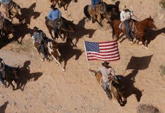 The Bundy family and their supporters fly the American flag as their cattle were released today by the BLM back onto public land outside of Bunkerville.