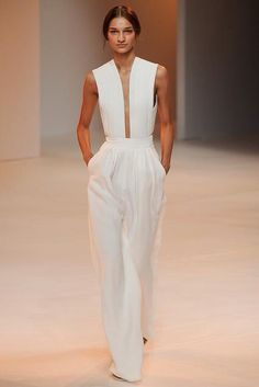 Porsche Design Spring 2015 #nyfw - a collection that shows the knowledge of fabrics and function that designer Thomas Steinbruck brings to this brand. The show was comprised of a series of neutrals and soft fabrics styled in a mix layered and transparent looks.