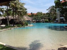 The Lagoon Pool at the Conrad Bali Resort even has its own little beach areas. Lagoon Pool, Bali Resort, Beach, Outdoor Decor, Seaside