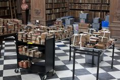 Crewe books were moved to the Wren Library and were temporarily stored on tables, trolleys and in crates, organised by century. Staff kept working on checking dates and sorting the books in different groups. Trinity Library, Cambridge, Wren, Sorting, Crates, Tables, College, Desk, Books