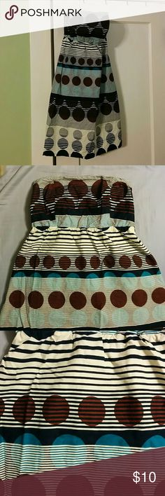 Polkadot Strapless Dress Polkadot strapless shift dress. Darts at the bust and elastic in back for a snug, comfy fit. Skirt is lined. Stripes are cream and navy. Polkadots are brown and teal. Dresses Strapless