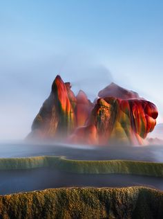 Fly Geyser near the Black Rock Desert in Nevada constantly erupts minerals and hot water creating bright colors and terraced pools. See all the things to do in Nevada. Beautiful Places To Visit, Places To See, Amazing Places, Fly Geyser Nevada, Places Around The World, Around The Worlds, Strange Places, Scary Places, Natural Phenomena
