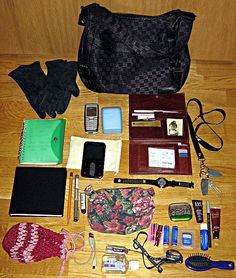 My purse of the moment. The contents of my purses reflect their size. This is a medium-sized handbag, so there are a few items missing that I carry in my bigger purses, such as a filofax full of useful stuff, a pencil case with different coloured pen