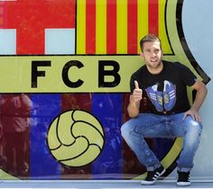 REUTERSSpanish soccer player Jordi Alba poses with a giant FC Barcelonas logo in front of their office in Barcelona, July 4, 2012. Alba will sign a five-year contract with Barcelona  (14 Mio Euro for the transfer...)