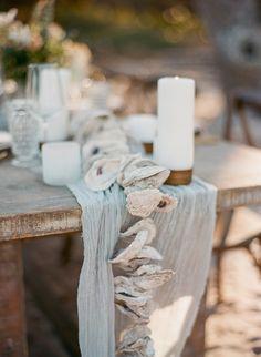 unique beach wedding table runners - photo by The Ganeys http://ruffledblog.com/intimate-wedding-inspiration-on-driftwood-beach