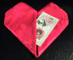 How to fold a napkin into a heart shape