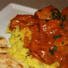 Chunks of chicken simmer in a spicy tomato and cream sauce for the bright orange chicken tikka masala you crave. Tikka Masala Sauce, Chicken Tikka Masala, Fried Chicken Recipes, Masala Recipe, Sauce Recipes, Curry, Easy Meals, Large Skillet, Stuffed Peppers