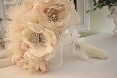 DIY fabric bouquet tutorial. fabric, pearls, styrofoam ball, dowel rod, plastic flower holder, glue gun, broaches. BAM.