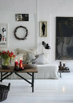 loving these white hardwood floors, the simple coffee table and the plain wreath on the wall.