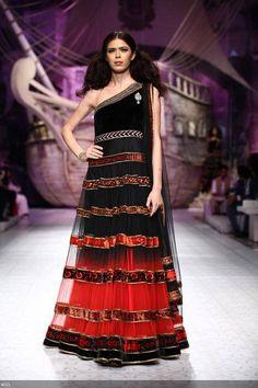 Sucheta Sharma showcases a creation by designer JJ Valaya on Day 1 of India Bridal Fashion Week, held in New Delhi, on July 23, 2013.