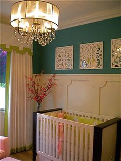 Forget a nursery, that board & batten wall (and the color, and the mirrors) are gorgeous for any room.