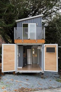 This is a two-story shipping container tiny house for sale that's totally unlike anything I've seen before! Designed by BoxedHaus, it has beautiful modern finishes, an upstairs bedroom … Container House Design, Tiny House Design, Design Studio Office, Shipping Container Homes, Shipping Containers, Tiny Houses For Sale, Tiny House Plans, Trendy Home, New Homes