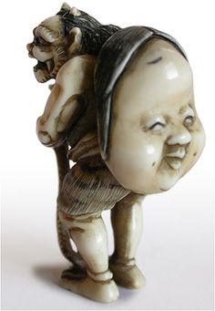 19th Century Japanese Carved Oni with Okame Mask Ivory Netsuke Signed Yasumasa