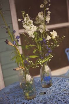 blue white wild flowers  © - Christy Blanch Photography / French Wedding Style Blog - flowers in champagne glasses?