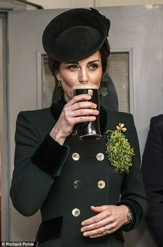 Catherine, Duchess of Cambridge takes a drink of Guinness as she meets with soldiers of the 1st battalion Irish Guards in their canteen following their St Patricks day parade at Cavalry Barracks on March 17, 2017 in London.