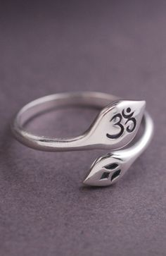 This om and lotus flower ring is sterling silver and fits most! Adjusts from approximately a size 6 to a size 9. Ready to ship and perfectly pairs with all of our personalized jewelry. Handmade in Tha