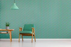 Pilon Baron is the lord of all skies and higher spheres. Get in the right direction with a feature wallpaper in green and geometric style. Original patterned design products by VAYAGE.