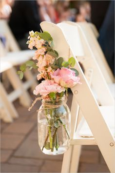 Rustic wedding decor with mason jar flower vases. Photo by: Ryan and Denise Photography #weddingchicks