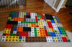 """I made this Lego quilt by following this tutorial (http://www.weewonderfuls.com/2011/03/oscars-lego-quilt.html) with a few alterations. I used fabric paint instead of an ink pad for the Lego stamp, and instead of quilting it """"stitch in the ditch"""" style I sewed straight lines 1/4"""" on both sides of each seam. It was my first quilt, and a gift for my nephew. I'm really happy with it!"""