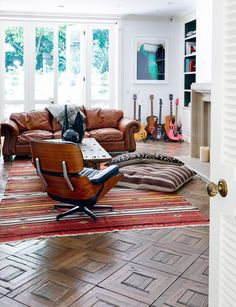 Leather sofa and Eames lounge chair in musical living room