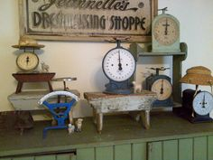 Love the little stools used in this display of vintage scales :)