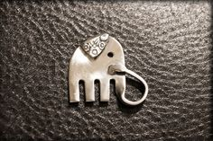 Baby Ele Keychain is my own design variation on some silverware elephants out there! He is created with hand a hand selected fork and a tig welder,
